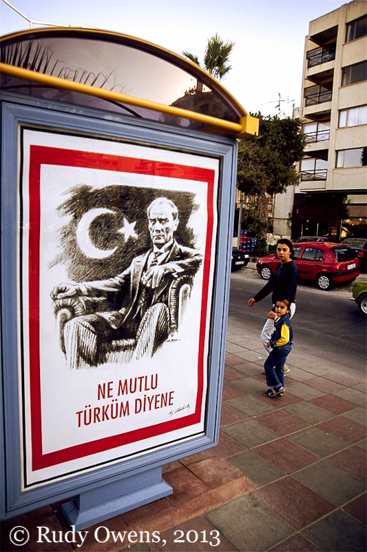 A picture of modern Turkey's first leader decorates a bus stop in western Turkey (2001).