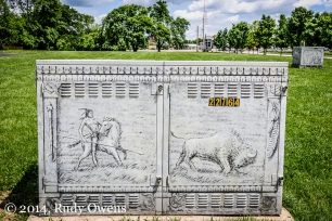 This picture of a buffalo hunt decorates an electric utility box near Forest Park, in St. Louis, Mo., (Taken in May 2013.)