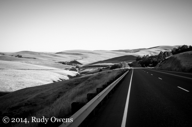 The sun casts shadows on the rolling farm country of Wasco County, Oregon, near the Dalles.