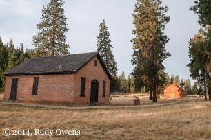 The powder magazine and stable are captured in the morning light at Fort Spokane.