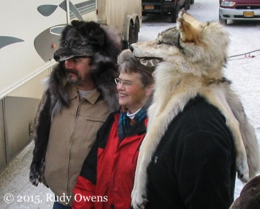 I shot this photo of two Alaskan men posing with a woman at the ceremonial start of the Iditarod in 2006. Pelts of killed wolves are sold here, and many trappers proudly show off their prizes with this head gear.