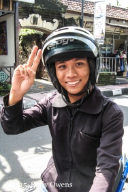 Balinese Man On Motorcycle Photo