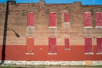 A common sight in St. Louis is plywood in the window set against a brick facade.