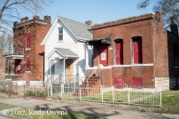 Three abandoned homes, just south of Manchester Avenue