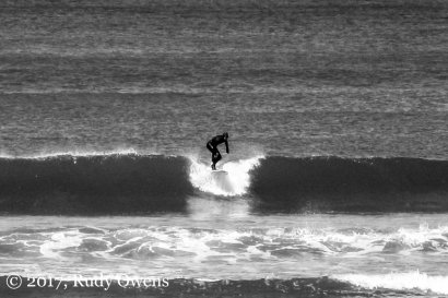 A spring surfer nailing it at Seaside
