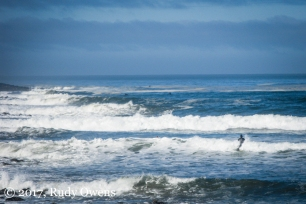 Punching through the breaks at Seaside can test the best surfer on a fall day.