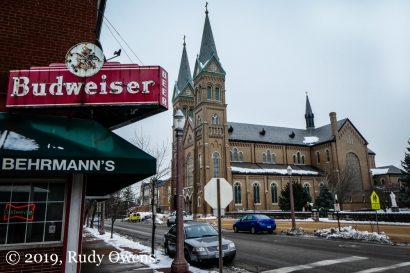 In St Louis, residents can kneel and then raise a glass, all on the same block. This is a shot of the St. Anthony of Padua Catholic Church on Meramac and Behrmann's Tavern.