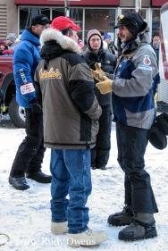 Norwegian musher and two-time Iditarod champion Robert Sørlie speaks with fellow mushers.